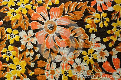 The sample of cotton fabric: brown-orange colors and floral patterns. Lightweight, absorbent fabric for sewing summer clothes - blouses, dresses, children`s clothes. Colorful and bright.