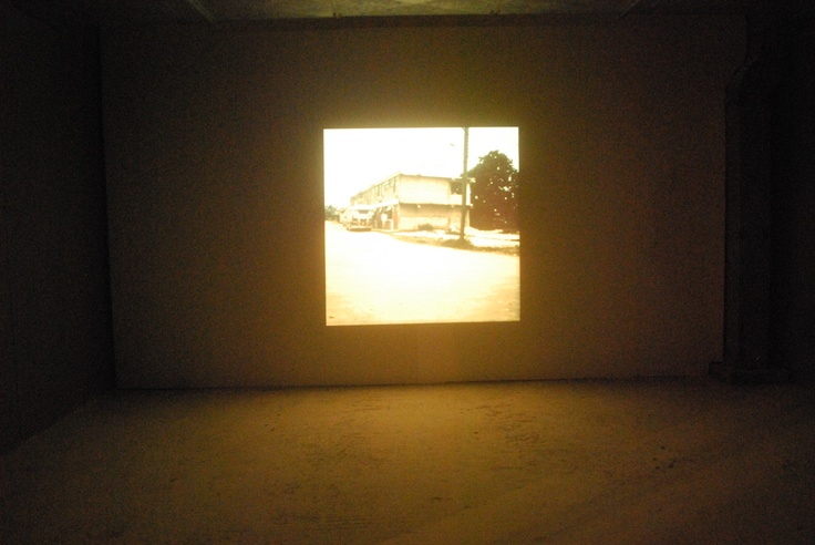 """Robert Smithson(1938-1973) Hotel Palenque,1969-72 thirty-one chromogenic-development slides, with audio recording dimensions variable Solomon R. Guggenheim Museum, New York Installation view, 2nd Athens Biennale 2009 """"Heaven"""""""