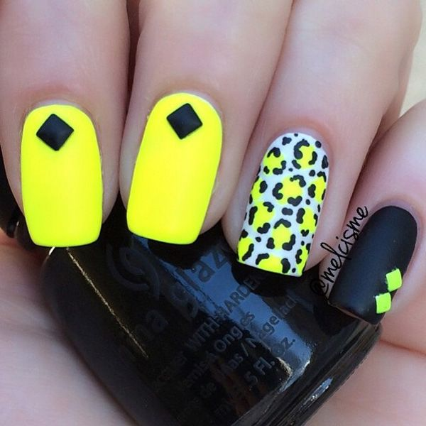 Bright yellow and black leopard nail art design. The contrasting colors of this design are absolutely stunning. You can definitely see the power that the visual effect holds and this design can be truly a stunner.
