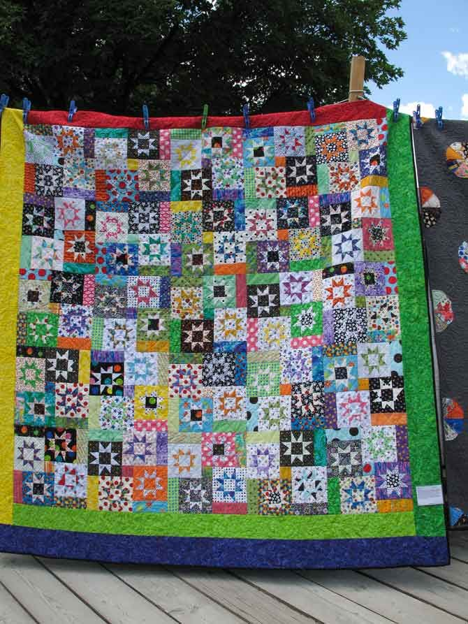 The dark and light colors in this scrappy quilt are in perfect balance.