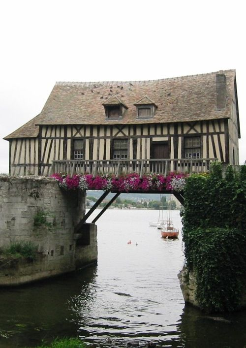 The old mill of Vernon (France), a half-timbered construction, lies straddling two piers of the ancient bridge over the Seine River.