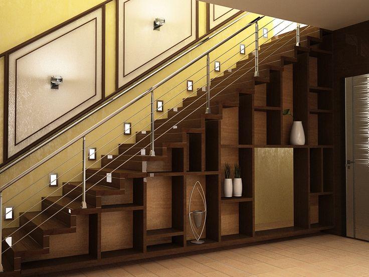 Под лестницей расположилась кладовая и конура домашнего питомца. Также под пространство ступеней вписан стелаж.