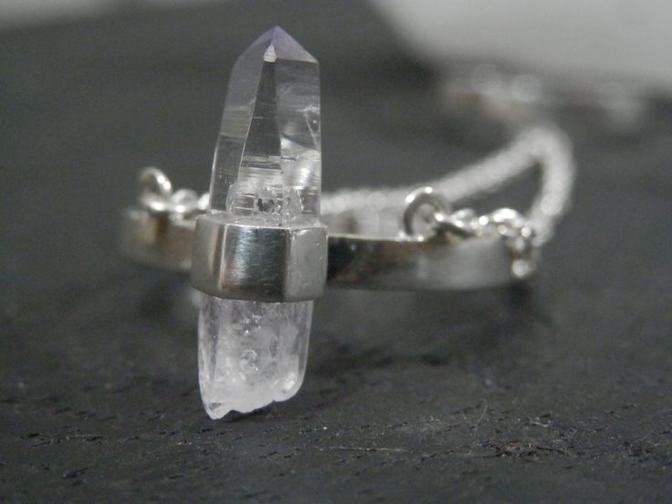 The chain ring is made to be worn with the large ring with the crystal at the bottom of the finger and the smaller ring on the top. This chain ring has a beautiful Vera Cruz Amethyst point. Each crystal is naturally shaped making every piece of Immortal Earth jewellery one of a kind. -Vera Cruz Amethyst Point-925 Sterling Silver-Crystal is approx 17mm-Size S on bottom, adjustable on topVera Cruz Amethyst is only found in one place in the world, Vera Cruz, Mexico. It ac...