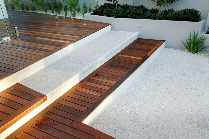 Our exposed aggregate concrete pairs perfectly with timber, creating a stunning effect for your outdoor area!
