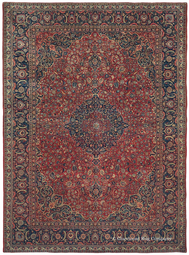 Dabir Kashan, 8ft 7in x 11ft 5in, Circa 1910. This resplendent early 20th century Persian carpet from the highly regarded Dabir Kashan rug workshop is a magnificent, full pile rendition of the classic Persian carpet from the Safavid tradition. Emanating from the carpet's kaleidoscopic central medallion, its crisp, lyrical design integrates astounding amounts of detail with swirling vinery and artfully curling fronds to create tremendous fluidity in both the field and border.