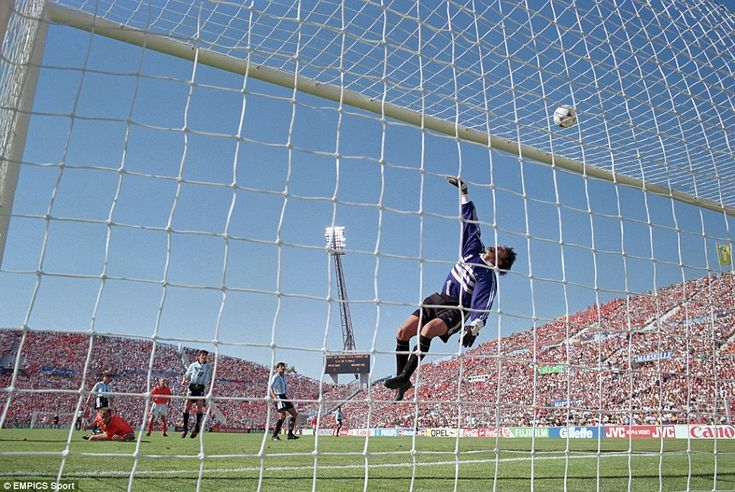Argentina's Carlos Roa saves from Holland's Kluivert in the 1998 World Cup.