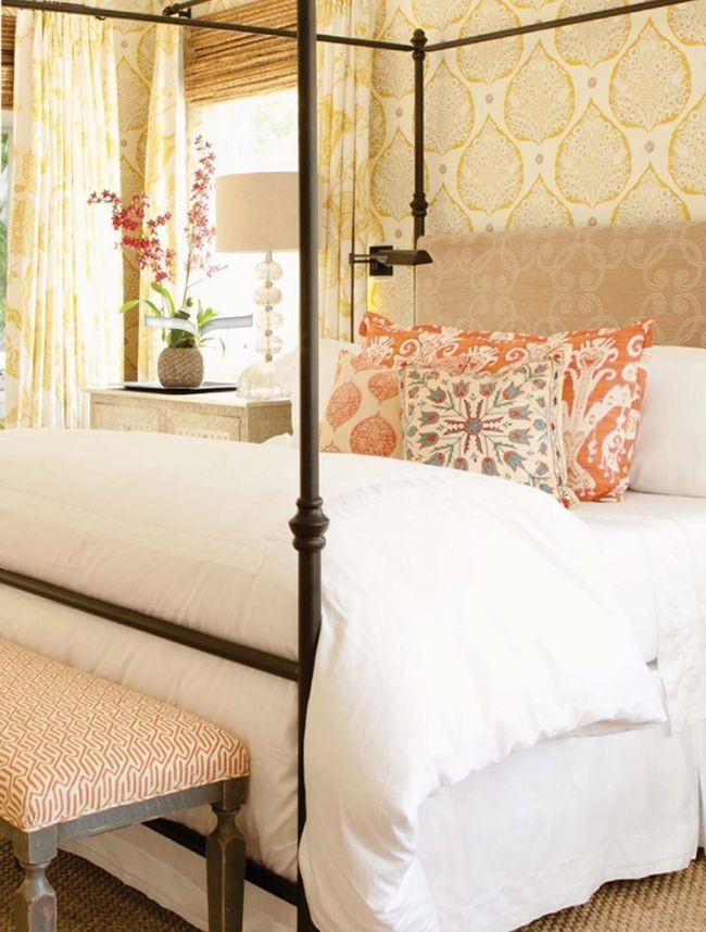 Love this big cozy bed with the white bedding and the bright pillow. Love the wallpaper mixed in with it all as well!