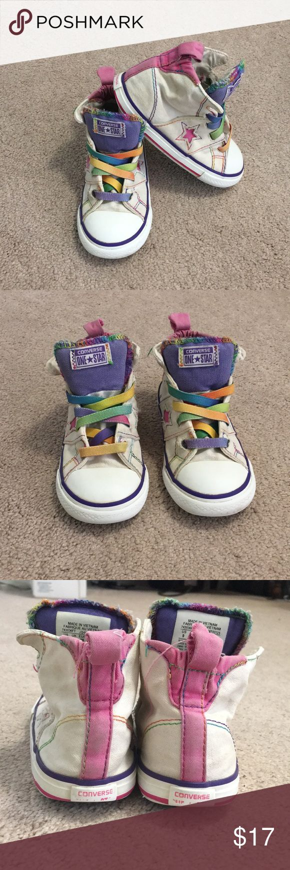 Converse One Star Toddler Hi-Tops - sz 9 Your little girl will have lots of fun in these funky White Converse hi-tops with rainbow laces! Elastic laces make it easy for your little to take her shoes on and off by herself.  Plenty of wear left and they look great with fun tights and tutu's!  Bundle and save bag! No trades! Reasonable offers considered! Questions? Ask away! Converse Shoes Sneakers
