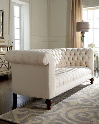 This traditional cream tufted sofa is beautiful!