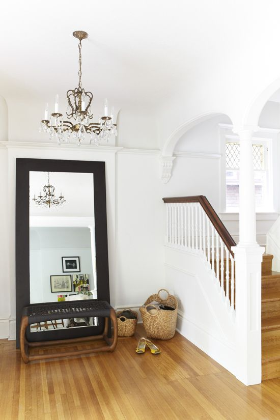 http://www.themarionhousebook.com - beautiful entry way. Love the mix of black, white and wood combined with the natural materials in the baskets, seat and floor.