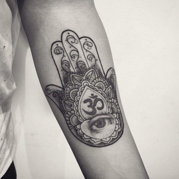 Hamsa hand on forearm by Raul Wesche