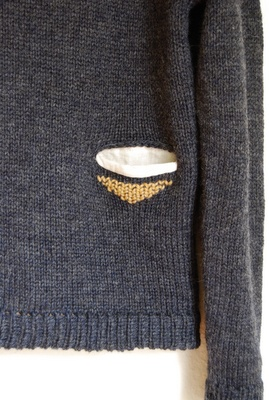 add a woven pocket to a sweater and embroider under it - Pocket detail on the Primoeza sweater.