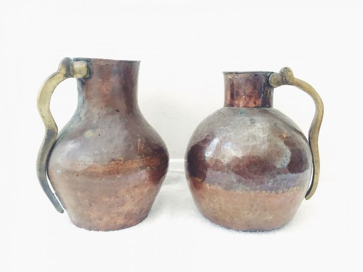 A stunning pair of antique jugs in brass and hammered copper with the most wonderful patina on both