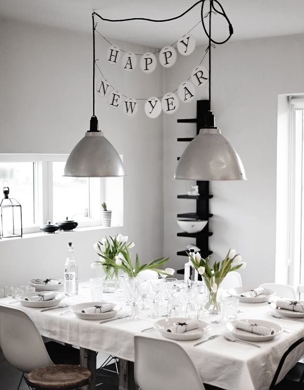 gorgeous all-white tablescape + happy new year banner