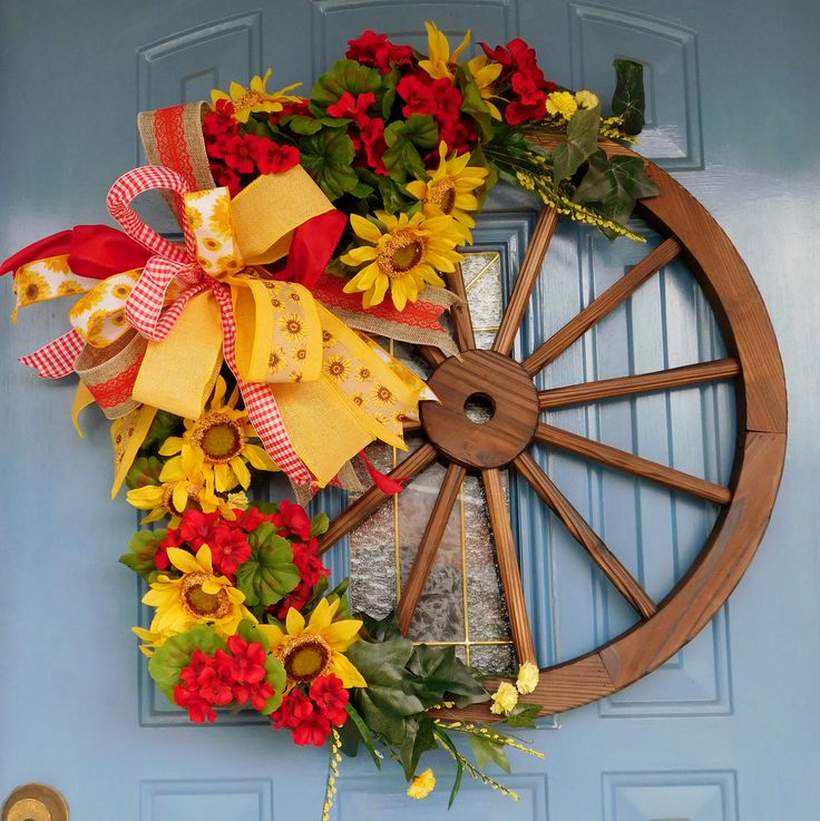 Wooden Wagon Wheel with Sunflowers and Red Geraniums and a Large Bow Wreath, Front Door Wreath, Back Porch Decor, Barn Decor, Sunflower by TwoRoadsDivergedShop on Etsy