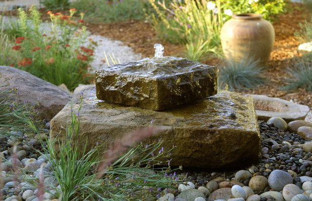 Stone on stone water fountain a small space seems larger for Small garden waterfall features