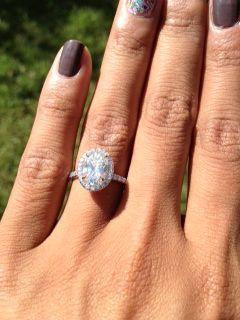 75 Center Diamond Halo Engagement Ring On Finger Images 12