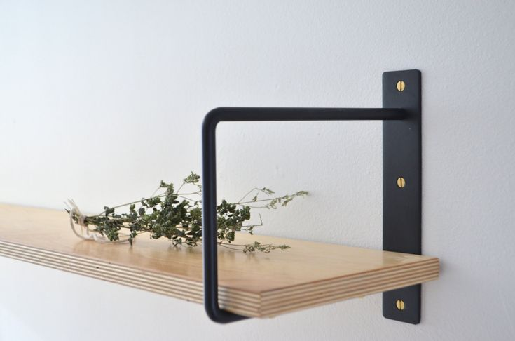 Loving these shelf brackets. They would go with any decor T!he Classic Minimalist Shelf Brackets are available in matte black ($61.36), glossy white ($65.19), and brushed steel ($65.19) from Etsy.