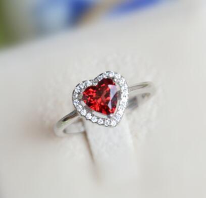 garnet heart ring http://www.jewelsin.com/p-fancy-timeless-heart-shaped-garnet-promise-anniversary-ring-in-silver-1369