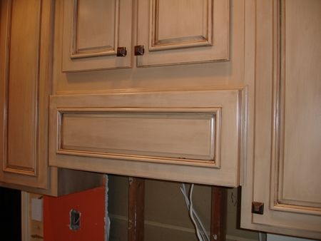 This is the look that I am going for on my kitchen cabinets... cream colored with an antique glaze...