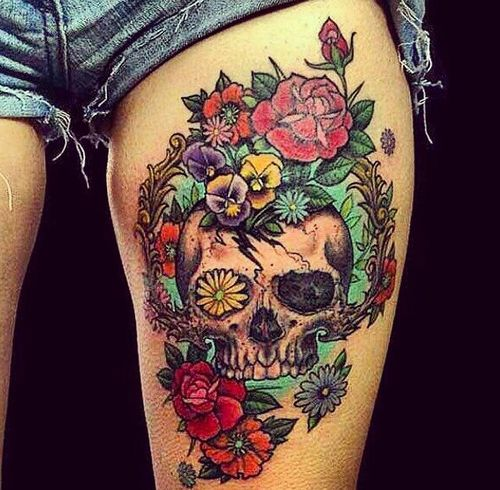 Floral skull thigh tattoo