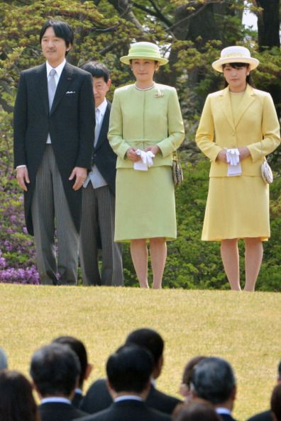 Princess Mako (R), daughter of Prince Akishino (L) and Princess Kiko (C), attends the annual spring garden party at the Akasaka Palace imperial garden in Tokyo on April 17, 2014.
