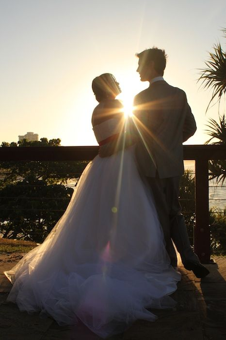I love to take a sunset wedding photo! Definately my favourite shot.