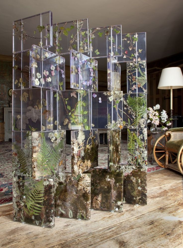 Sasha Sykes articulating screen in Lisnavagh Library, foliage and flowers encased in resin and acrylic.