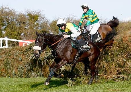 Many Clouds ridden by Leighton Aspell on his way to winning the 2015 Crabbie's Grand National at Aintree