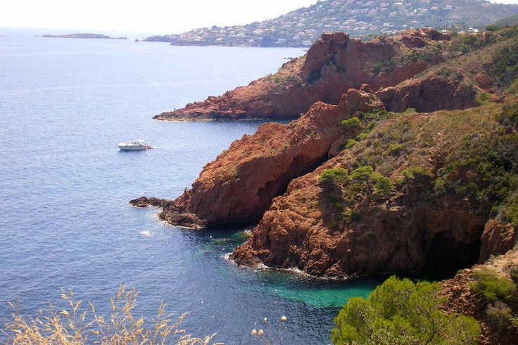 The red rocks of the Esterel. Indian summer on the French Riviera. Between Saint-Raphaël and Mandelieu, the volcanic rocks of the Massif de l'Esterel do not blush to jump into the blue Mediterranean, composing landscapes among the most beautiful in France.