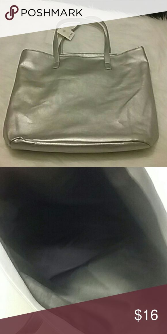 NEW Tote Bag Brand new tags attached shiny silver tote bag one big black lining inside. Size LARGE. NEW NEW NEW! ! ! Bags Totes