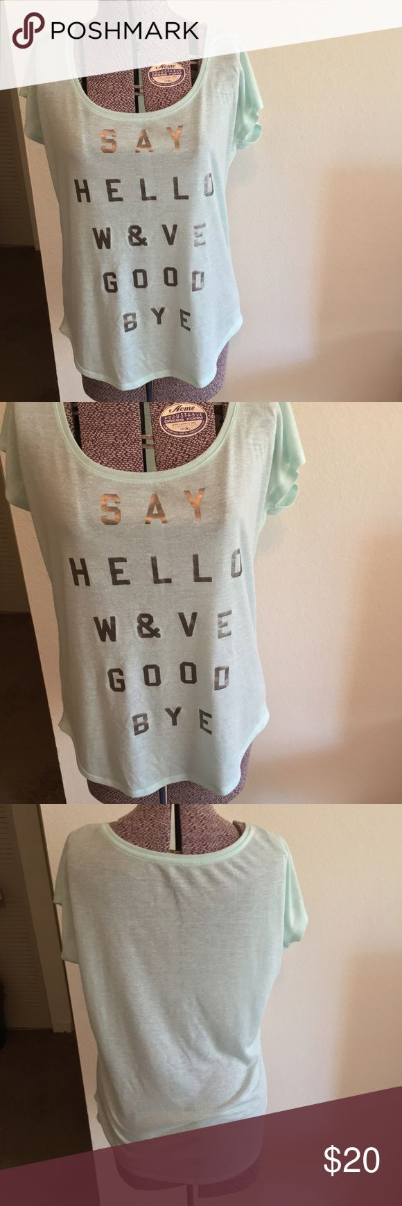 """American Eagle  """"Say Hello Wave Goodbye"""" Tee Adorable semi-sheer American Eagle Outfitters seafoam green tee! """"Say Hello Wave Goodbye"""" is the saying on the shirt. Perfect Condition shirt. Size Medium. 80% Polyester, 20% Linen. 22"""" armpit to armpit (laying flat), 25"""" shoulder to hem. American Eagle Outfitters Tops Tees - Short Sleeve"""