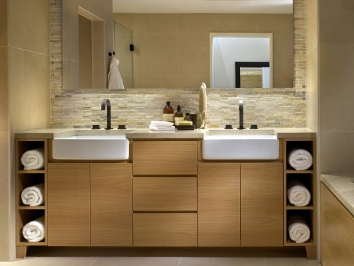 Bathroom by Raven Interior Design-the open cabinets for towel storage and skirted sinks reduce the visual heaviness of the piece and add interest to the space.