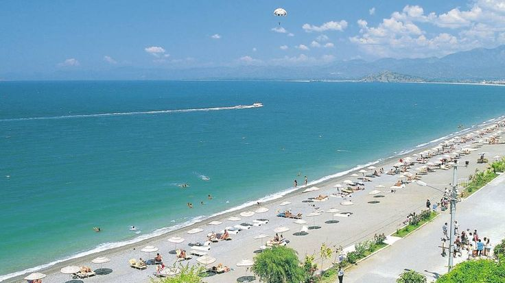 Calis Beach, Fethiye - This fabulous beach boasts deep, crystal clear, blue seas and has become a very popular holiday resort on Turkey's turquoise coast.