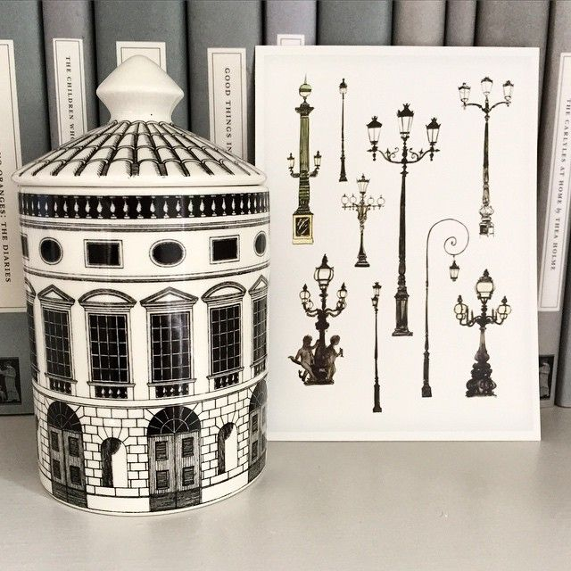 At home- some of my drawings of Paris lamp posts in scale with a Fornasetti candle. The novels are from Persephone books in Lamb's Conduit Street. #london #paris #parispostcards #fashionillustration #jasonbrooks #fornasetti #illustration #drawings #sketch #sketches #interior #books #drawing #interiors #library #persephonebooks #art #artist #home @laurencekingpub @fornasettiofficial