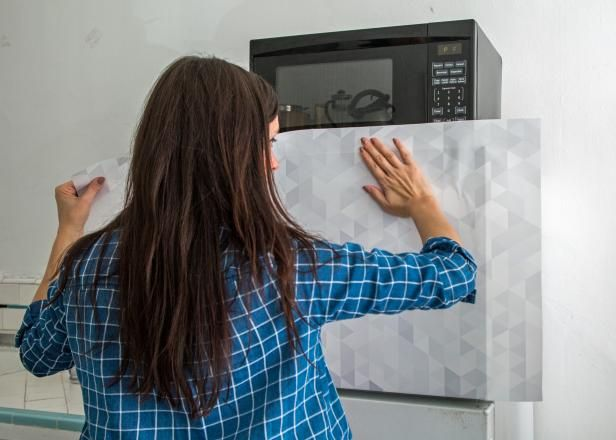 Give Your Refrigerator a Makeover With Removable Wallpaper (Renter-Friendly) >> http://www.diynetwork.com/how-to/make-and-decorate/decorating/how-to-cover-a-refrigerator-with-wallpaper?soc=pinterest