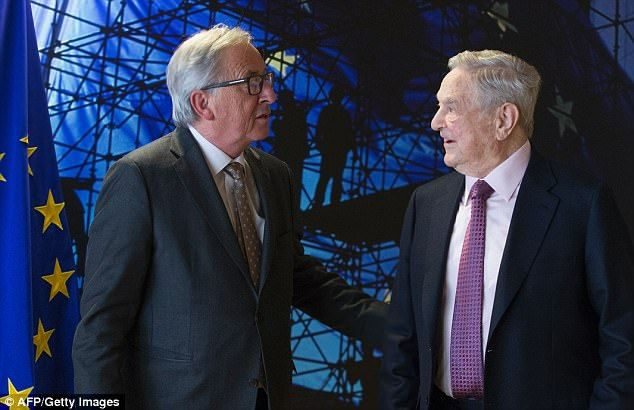 THE AXIS OF EVIL! Mr Soros (pictured with EU commission President Jean-Claude Juncker in 2017), previously s...