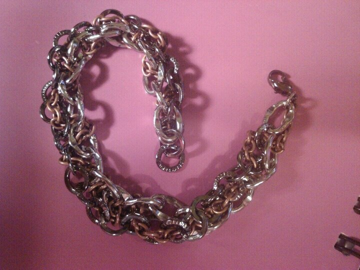I got 3 different chains & weaved the 2 larger chains using the smaller chain. 1st time to ever make a bracelet!
