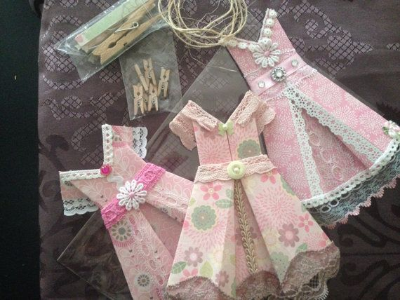 'Pretty in PInk' pack. $24.95: includes 3 x small origami dresses, 6 x miniature pegs for hanging, rustic twine 'clothesline' and 2 x self-adhesive decoupaged pegs for mounting as wall hanging. Perfect decor for girl's rooms, walk-in robes, laundries or anywhere you like! Purchase on Etsy - https://www.etsy.com/au/listing/182513003/pretty-in-pink-vintage-look-origami?