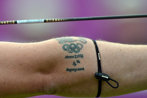 A tattoo on the arm of Larry Godfery of Great Britain is pictured as he competes against Juan Rene Serrano of Mexico during the archery men's individual elimination event on Day 3 of the London 2012 Olympic Games at Lord's Cricket Ground on July 30, 2012 in London. (Jewel Samad/AFP/GettyImages)