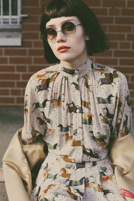 Cool retro Derby  print...love the bobbed hair and lipstick!
