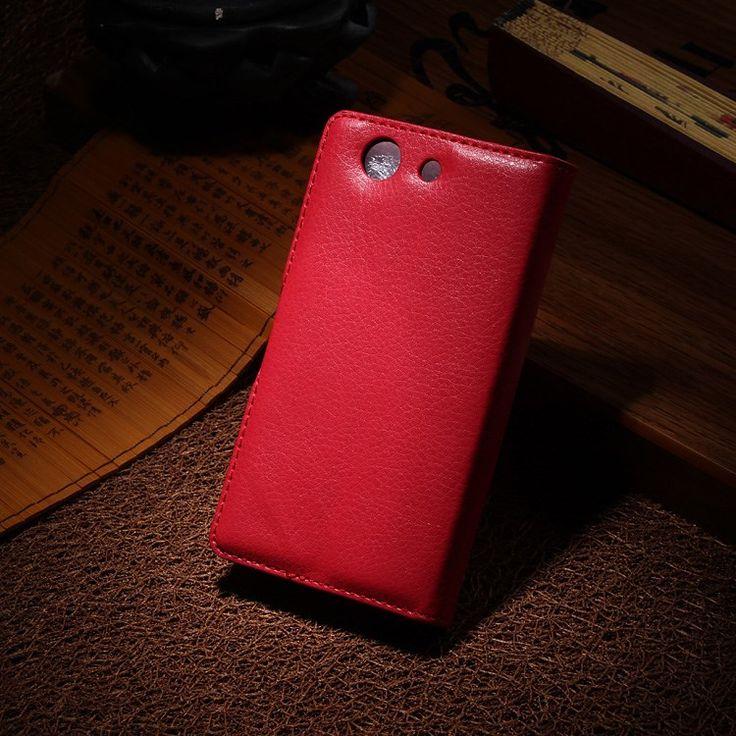 Sony Xperia Z3 Compact Stand Case Hoesje Rood  De stand case gemaakt van goede kwaliteit PU leer voor de Sony Xperia Z3 Compact is speciaal op maat gemaakt ter bescherming van je telefoon. De telefoon wordt vastgeklikt in de case gemaakt van stevig en goed plastic en zal erin blijven totdat je hem er zelf weer uit klikt. Naast dit handig systeem om je Sony Xperia Z3 Compact niet telkens uit een case te halen zijn er ook uitsparingen gemaakt in de case. Deze uitsparingen zorgen ervoor dat…