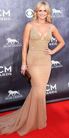 Rarely do all the editors here have the same exact reaction to a gown, but every single jaw at PEOPLE just dropped. Miranda Lambert makes that happen in a bod-flaunting nude gown featuring crystals and a cleavage-baring neckline, plus shoulder-skimming danglers. http://www.people.com/people/package/gallery/0,,20267558_20803849_30131093,00.html