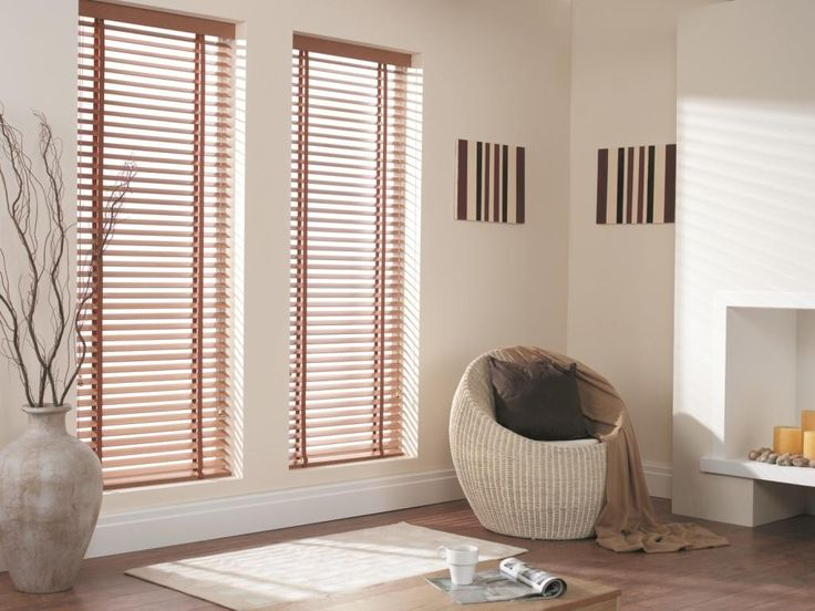 Venetian blinds are a perfect choice of window covering for a modern living room particularly twinned with a wooden floor in the same colour hues. #venetianblinds #woodenblinds #interiordesign