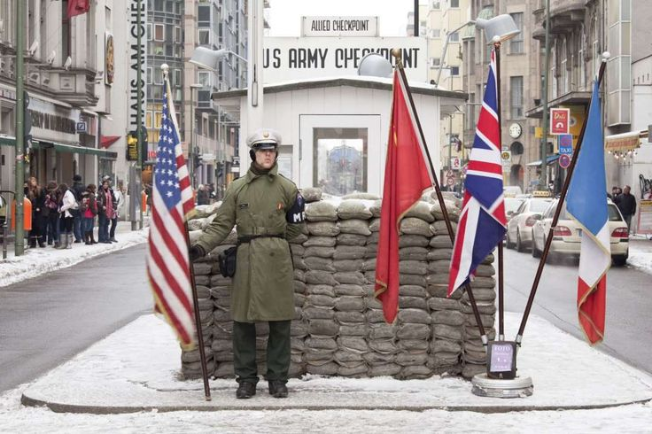 You've Probably Fallen For At Least One Of These Fake Tourist Attractions  --  February 24, 2017:      Checkpoint Charlie:    The original Checkpoint Charlie once stood between East and West Berlin, and was the site of many escapes by East Germans, according to  History. After the fall of the Berlin Wall, Checkpoint Charlie was moved to a museum, and this replica version was installed as a tourist  attraction.