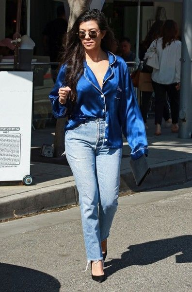 Kourtney Kardashian Photos Photos - Reality star Kourtney Kardashian is spotted out running errands in Los Angeles, California on March 20, 2017. Kourtney was sporting a blue silk pajama shirt with her name embroidered on it and driving her brand new Ashton Martin. - Kourtney Kardashian Running Errands In Los Angeles