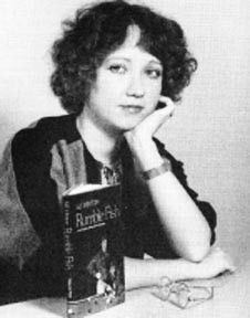 S.E. Hinton, the author of The Outsiders, with another one of her books, Rumble Fish