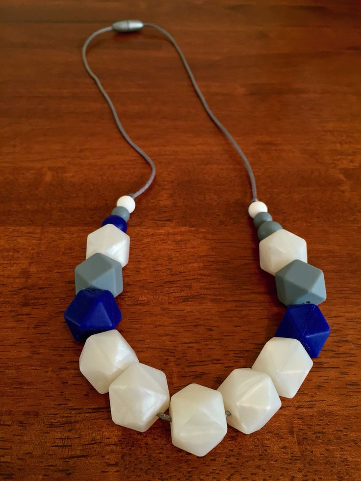 Silicone Teething Necklace - Fussy Little Fox Hexagon Teething Necklace in pearl white, navy and grey on silver nylon cord with silver safety catch. $30 + Free Shipping within Australia. Visit Fussy Little Fox on Facebook to see more or email fussylittlefox@gmail.com to purchase.