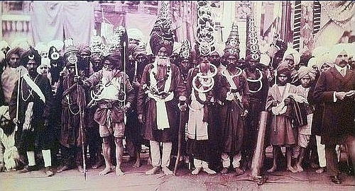 By the turn of the last century the Akali Nihang dress tradition   was getting a bit extreme.  The Akali army was called the Akal Sena or Akal Fauj but was informally known as the Budha Dal or army of Baba Budha Ji. Its primary function was to defend Sikhism and all who sought the protection of the Sikhs from the then oppressive Mughal empire.