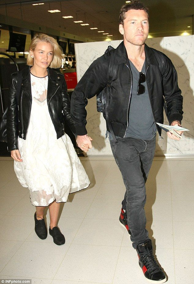 Lara Bingle and Sam Worthington - At Sydney International Airport. (May 2014)
